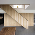 The oak staircase cuts through the living space