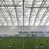 The football pitch roof uses an asymmetric arch profile