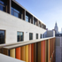 To the rear, the building is clad in fins bearing colours sampled from surrounding buildings