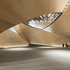 The foyer space is formed by curved timber shells