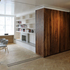Sliding partition reveals living room beyond