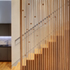 Timber fin wall against stairway