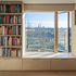 Dormer interior and loft library wall - window seat with view of allotments and skyline