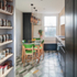 A larder area acts as transition from living to kitchen and dining spaces, with dark stained plywood units wrapping around to form another window seat