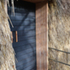 Sliding entrance door, using charred larch and douglas fir