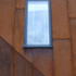 Corten cladding, sloping aluminium window