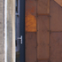 corten detail, aluminum door