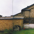 Courtyard with outbuildings to be demolished