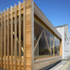 The western red cedar louvres act as a symbol of the works behind